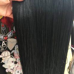 Franjuri lungi negre